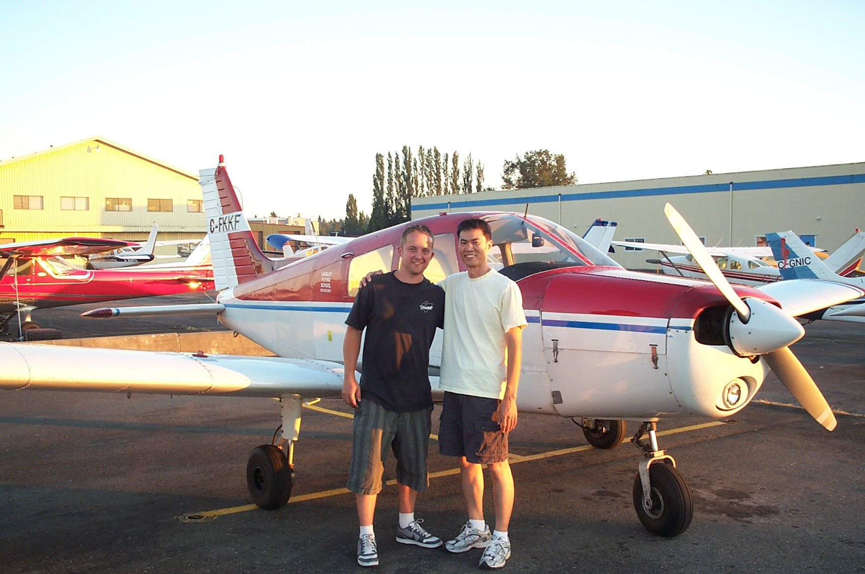 Private Pilot Gradute Jason Nel with his Flight Instructor, Hoowan Nam.  Langley Flying School.