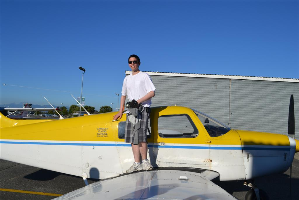 Jeff Priest on the wing of Cherokee GODP after the completion of his First Solo Flight on August 27, 2011. Langley Flying School.