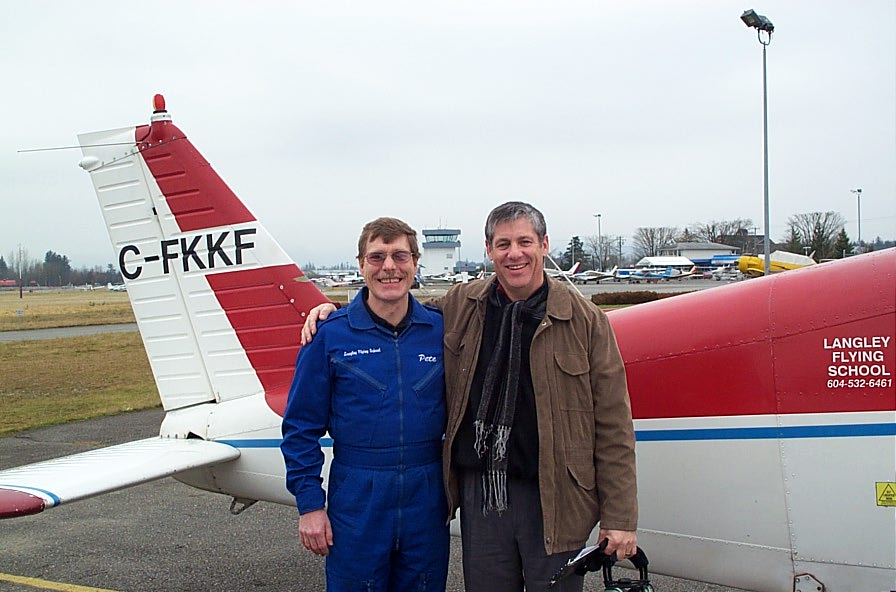 Joel Schacter with Flight Instructor Peter Waddington after the completion of Joel's First Solo Flight on January 17, 2008.  Langley Flying School.