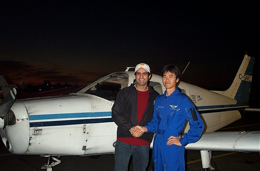 Karn Takkhar with Flight Instructor Hoowan Nam after the completion of Karn's First Solo Flight in Cherokee GNIC on November 4, 2007.  Langley Flying School