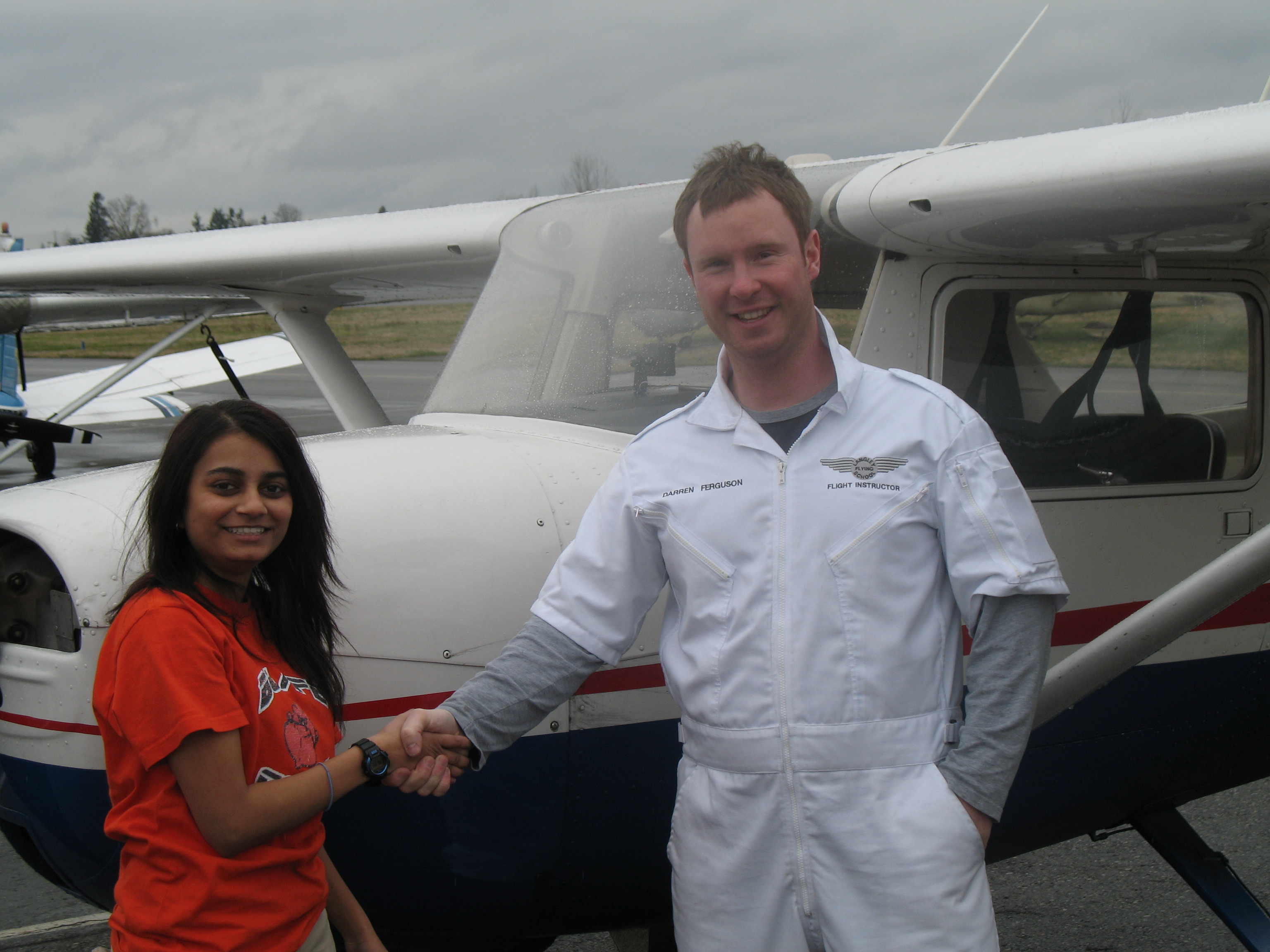 Khushbu Patel with Flight Instructor Darren Ferguson after completing her First Solo Flight on March 23, 2008.  Langley Flying School.