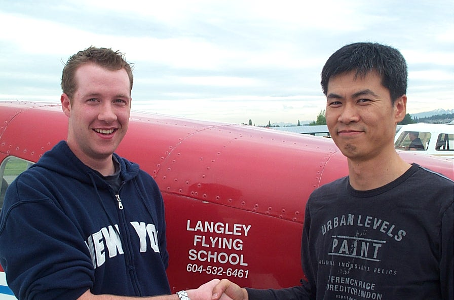 Kirk Palmer receives congratulations from Flight Instructor Hoowan Nam after the successful completion of Kirk's Private Pilot Flight Test on .  May 23, 2008.  Langley Flying School.