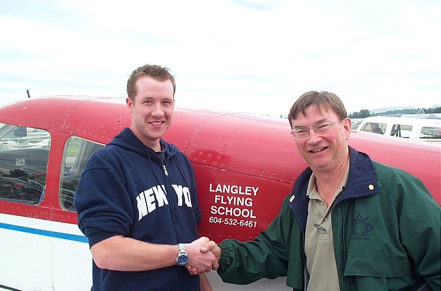 Kirk Palmer receives congratulations from Pilot Examiner John Laing after the successful completion of Kirk's Private Pilot Flight Test on May 23, 2008.  Langley Flyhing School.