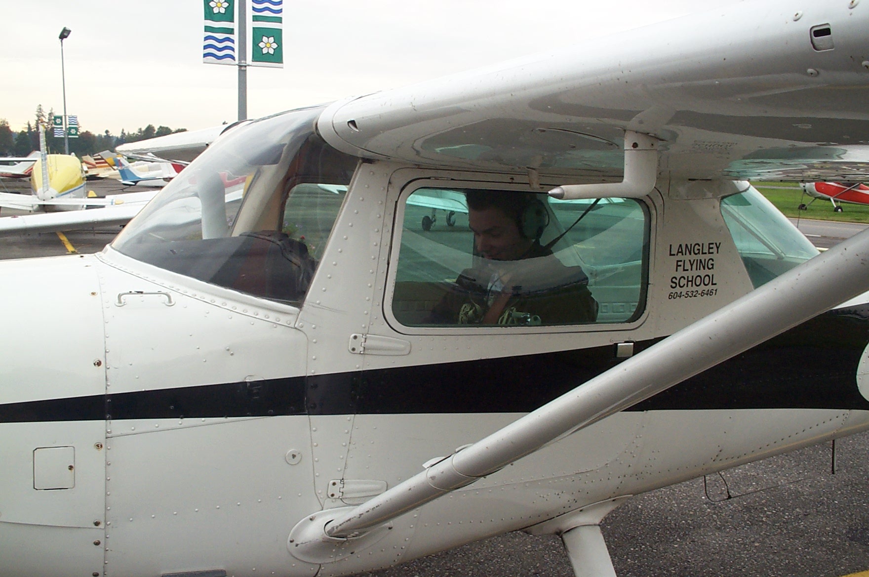 Kyle Rempel in the cockpit of Cessna GPUK.  Langley Flying School.
