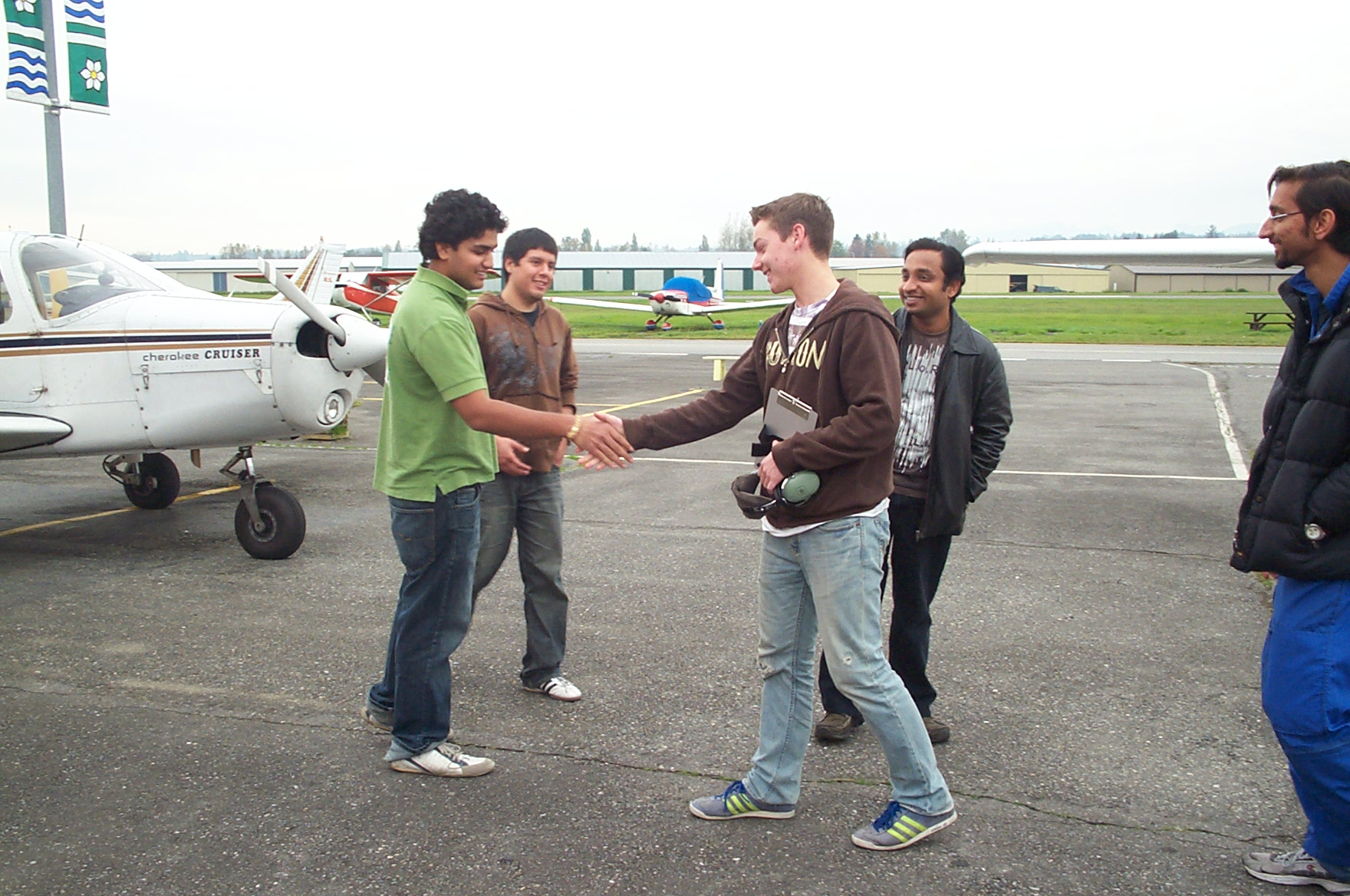 Kyle Rempel congratuled by fellow students following his First Solo Flight, October 18, 2010.