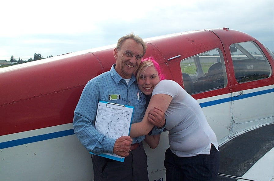 Private Pilot Liz Carrol with Pilot Examiner Francois Leh.  Langley Flying School.
