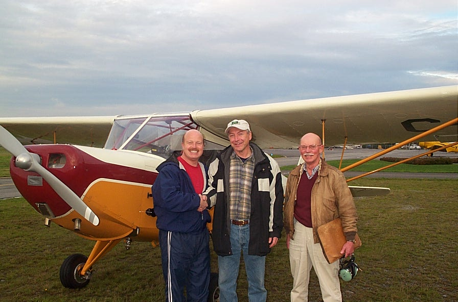 Lloyd Blackburn (centre) with Flight Instructor David Parry and Pilot Examiner Donn Richardson after the successful completion of Lloyd's Private Pilot Flight Test.  Langley Flying School.
