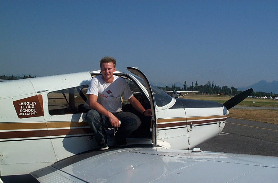 Lucas Turek on the wing of Cherokee GUKG after completing his First Solo Flight on August 6, 2008.  Langley Flying School.