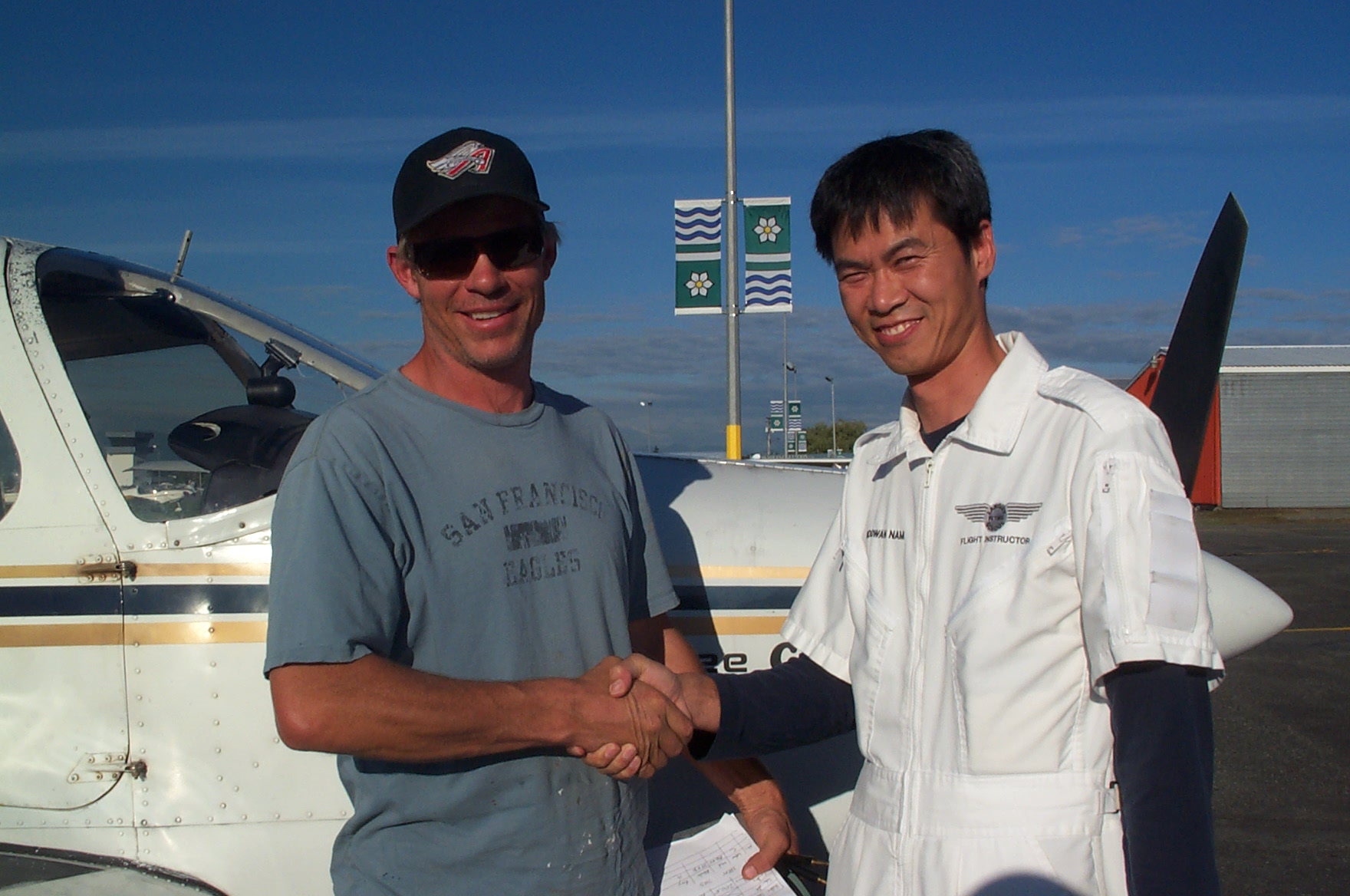 Darryl (Mark) Reid is congratulated by Flight Instructor Hoowan Nam after the completion of Mark's Second/First Solo Flight in Cherokee GCEP on September 22, 2010. Langley Flying School.
