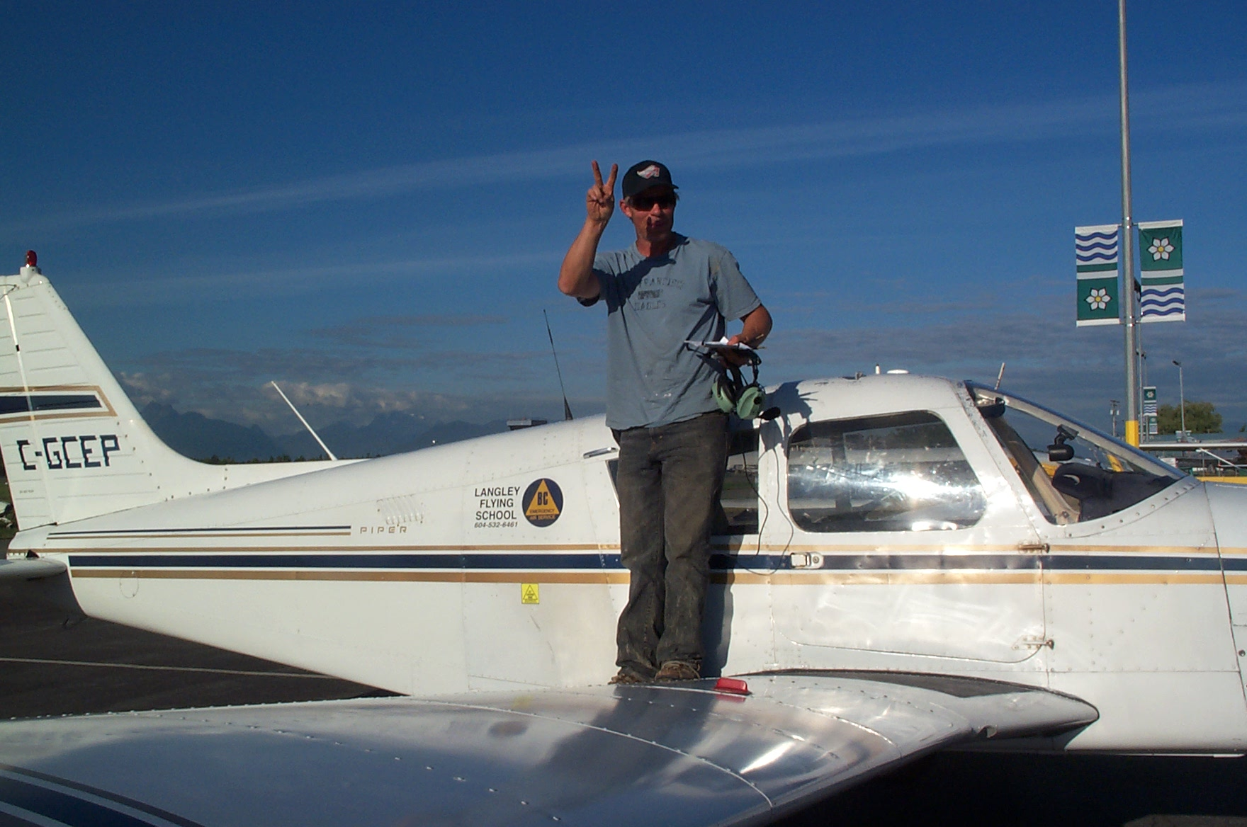 Mark Reid on the wing of Cherokee GCEP after the completion of his First Solo Flight on September 22, 2010.  Langley Flying School.
