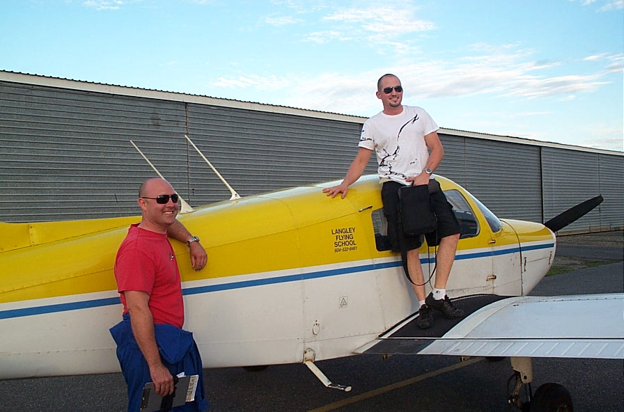 Matt Roesma on the wing of Cherokee GODP after the completion of his First Solo Flight on August 23, 2008.  Matt's Flight Instructor, Rod Giesbrecht, appears to the left.  Langley Flying School.