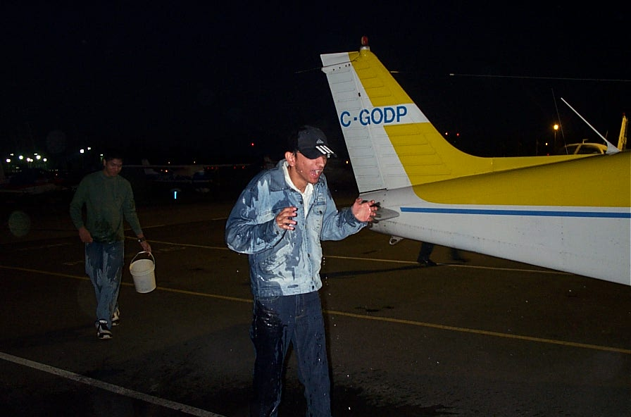 Mayank Mittal gets a soaking after completing his First Solo Flight on October 26, 2007. Langley Flying School.