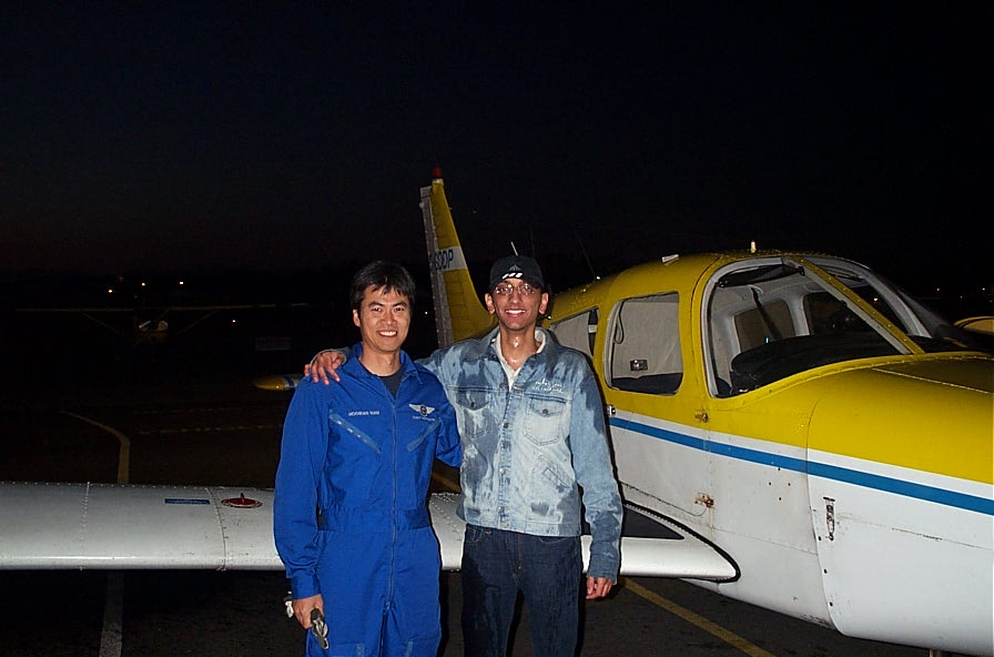 Mayank Mittal (after being soaked by fellow student pilots) with Flight Instructor Hoowan Nam after the completion of Mayank's First Solo Flight on October 26, 2007.  Langley Flying School.