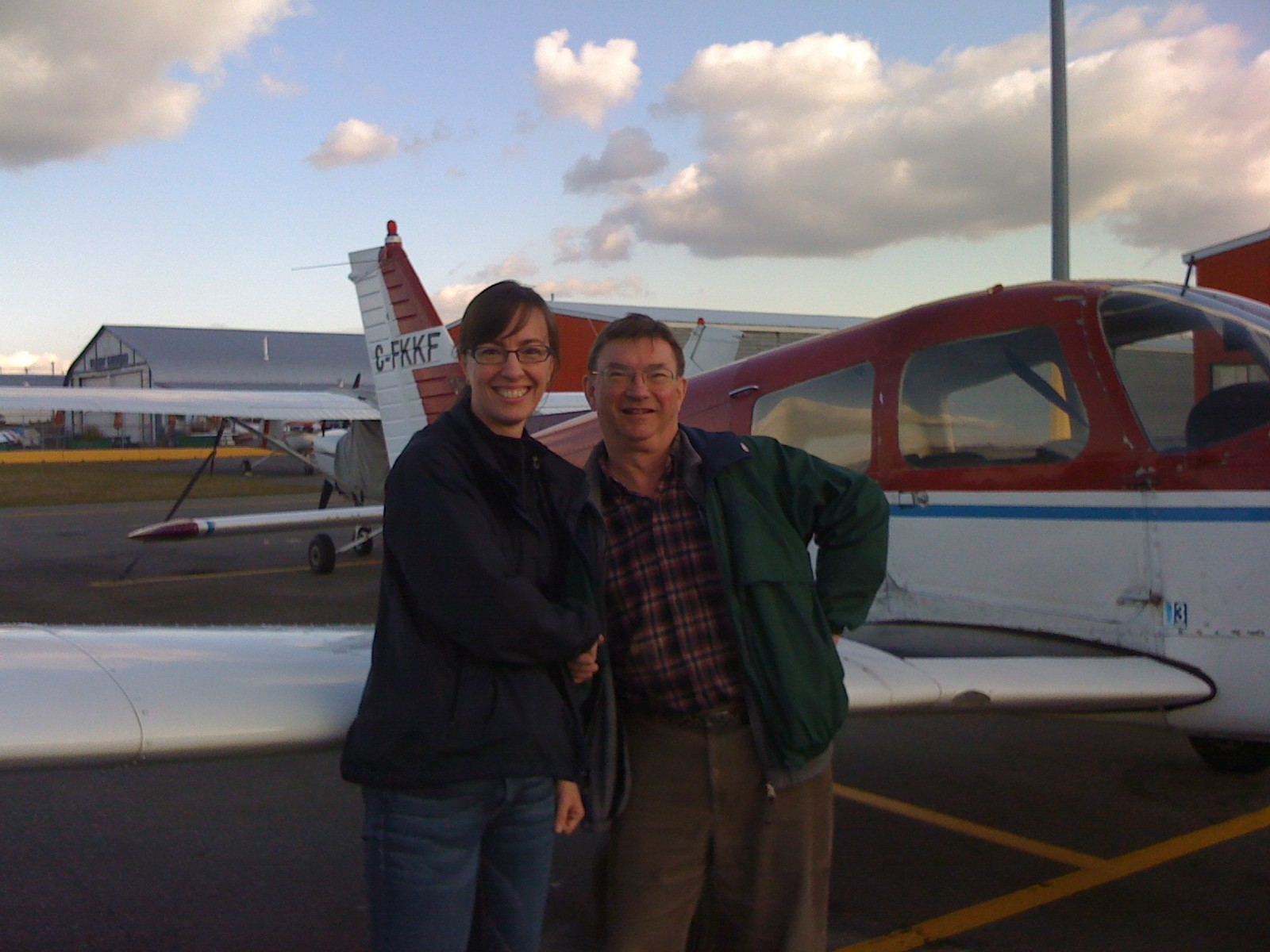 Michelle Thompson with Pilot Examiner John Laing after the completion of Michelle's Private Pilot Flight Test on October , 2009.  Langley Flying School.