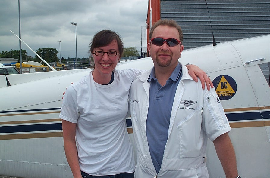 Michelle Thompson with Flight Instructor Dave Page after the completion of Michelle's First Solo Flight on June 13, 2008.  Langley Flying School.
