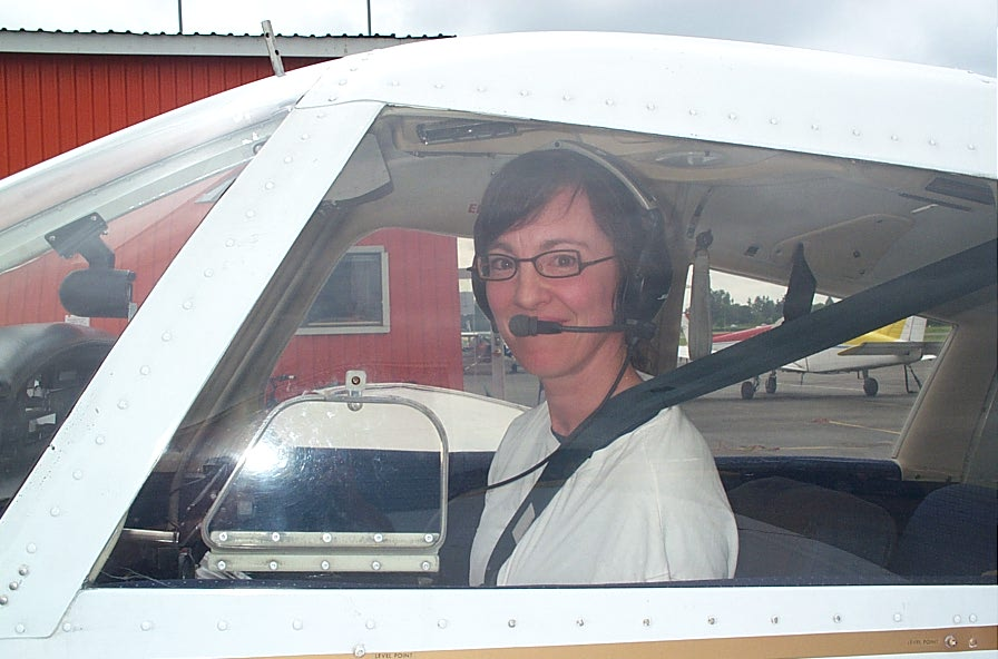 Michelle Thompson in Piper Cherokee GCEP after the completion of her First Solo Flight on June 13, 2008.  Langley Flying School.