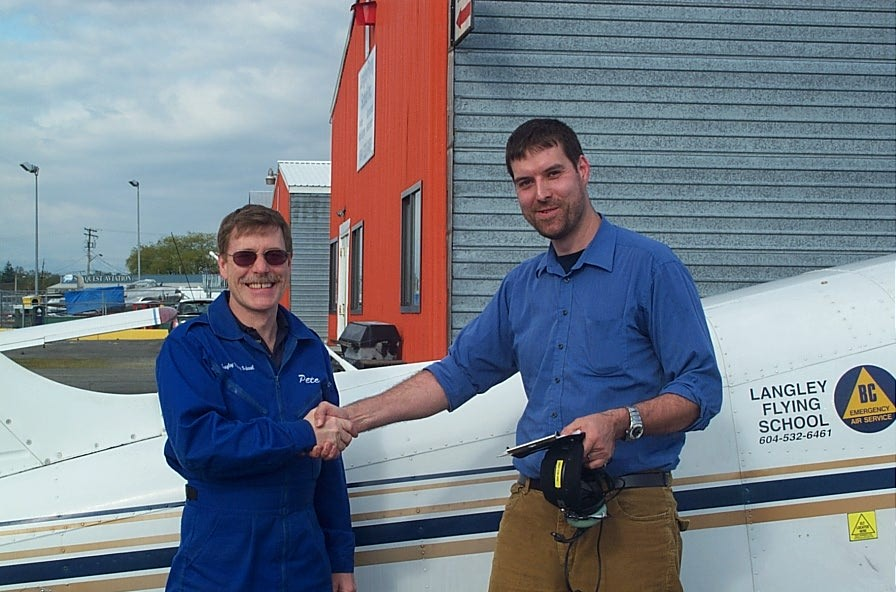Milan Veverka receives contratulations from Flight Instructor Peter Waddington after completing his First Solo Flight on May 8, 2008.  Langley Flying School.