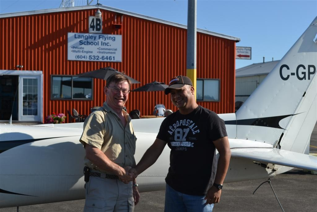 Commercial Pilot Mohit Agnihotri receives congratulations from Pilot Examiner John Laing following the successful completion of his qualifying flight test on August 17, 2011. Langley Flying School.