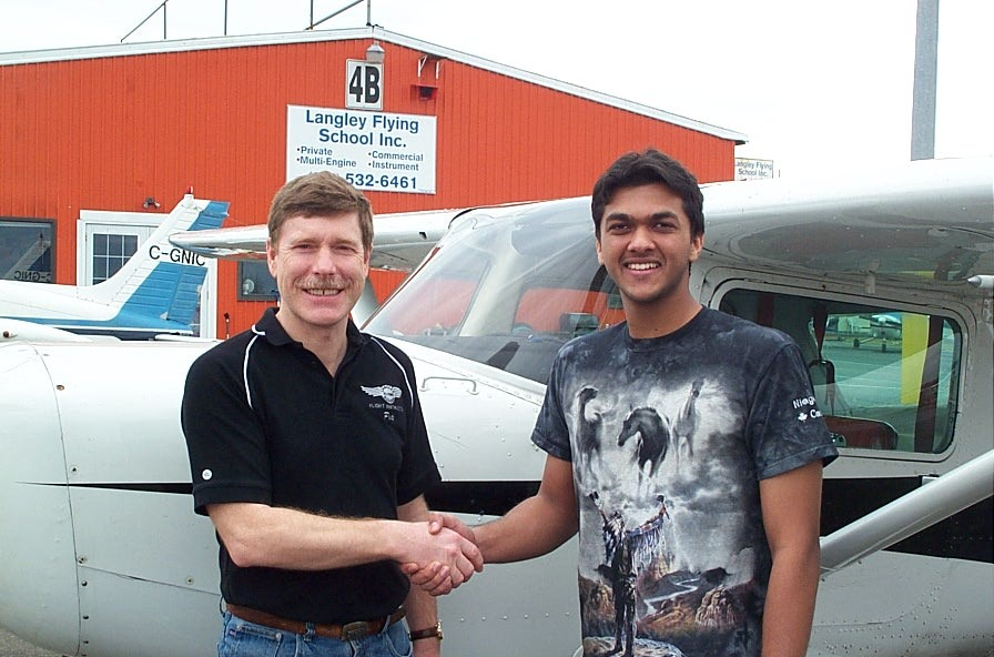 Mohit Goyle receives contratulations from Flight Instructor Peter Waddington after the successful completion of Mohit's Commercial Pilot Flight Test.  Langley Flying School.