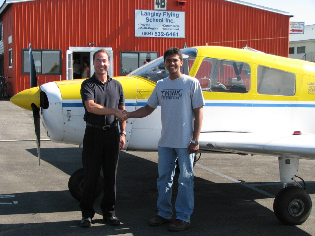 Mohit Goyle with Jeff Durand after successfully completing his Private Pilot Flight Test in Cherokee GUGK on August 6, 2007.  Langley Flying School