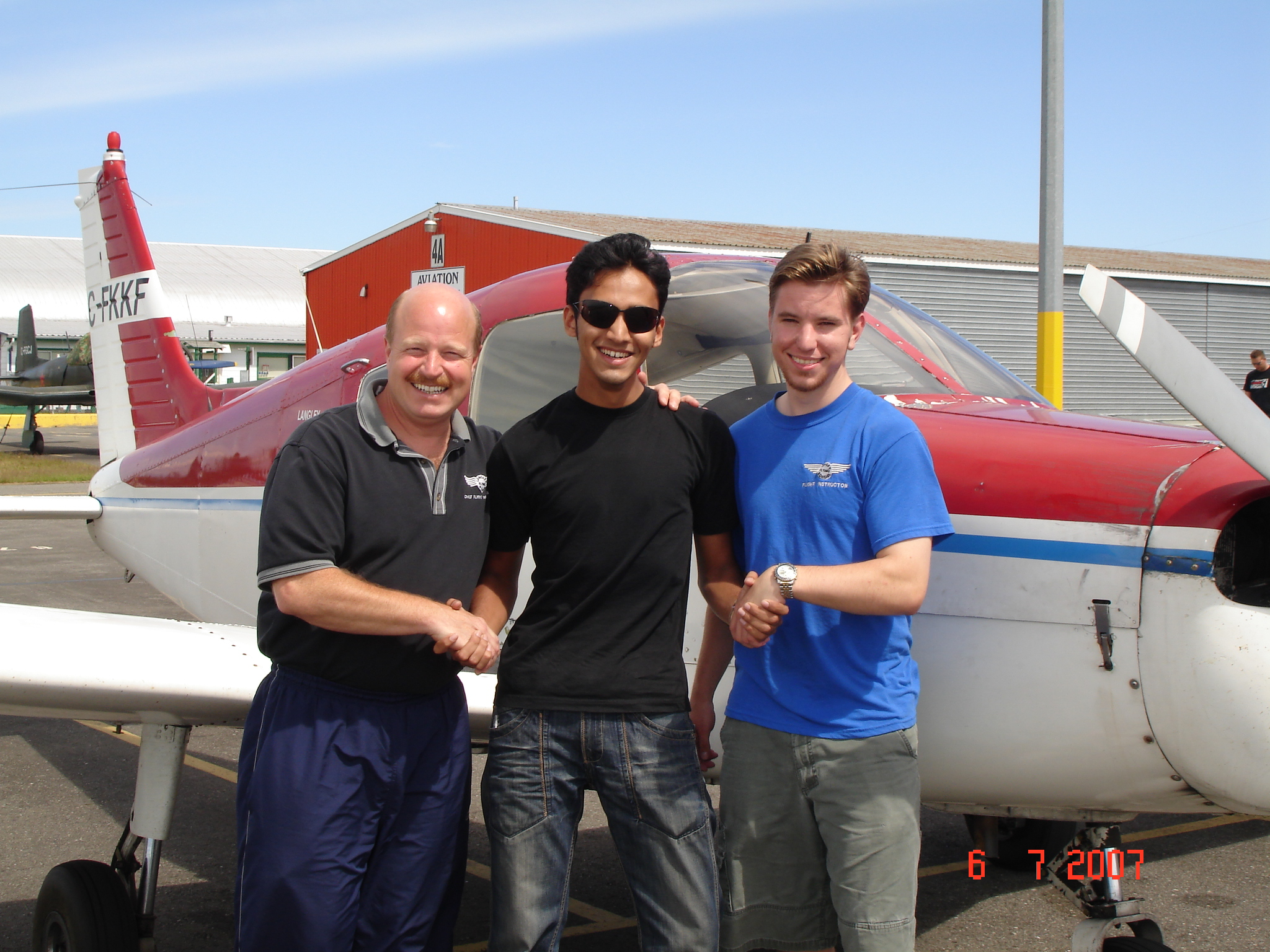 Naif Malvankar with David Parry and Philip Craig after the successful completion of his Private Pilot Flight Test, Langley Flying School