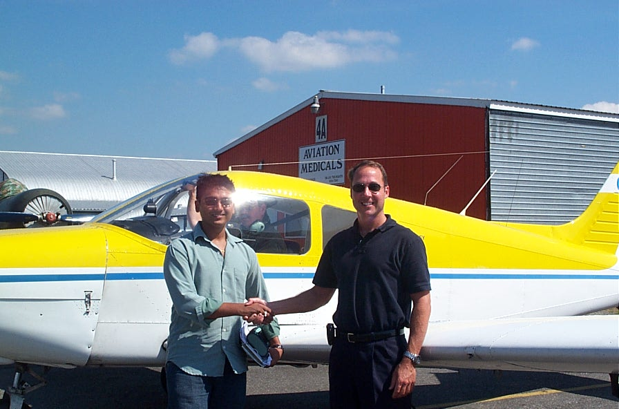 Nikhil Dongare with Jeff Durand after successfully completing his Private Pilot Flight Test on August 23, 2007