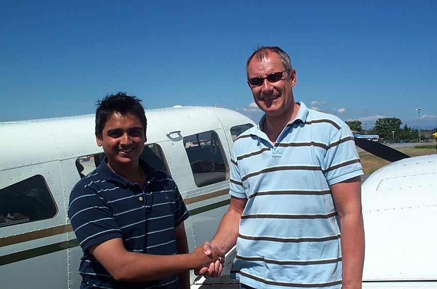Nikhil Dongare with Pilot Examiner Matt Edwards after the successful completion of Nikhil's Flight Test for his Multi-engine Class Rating on July 9, 2008.  Langley Flying School.