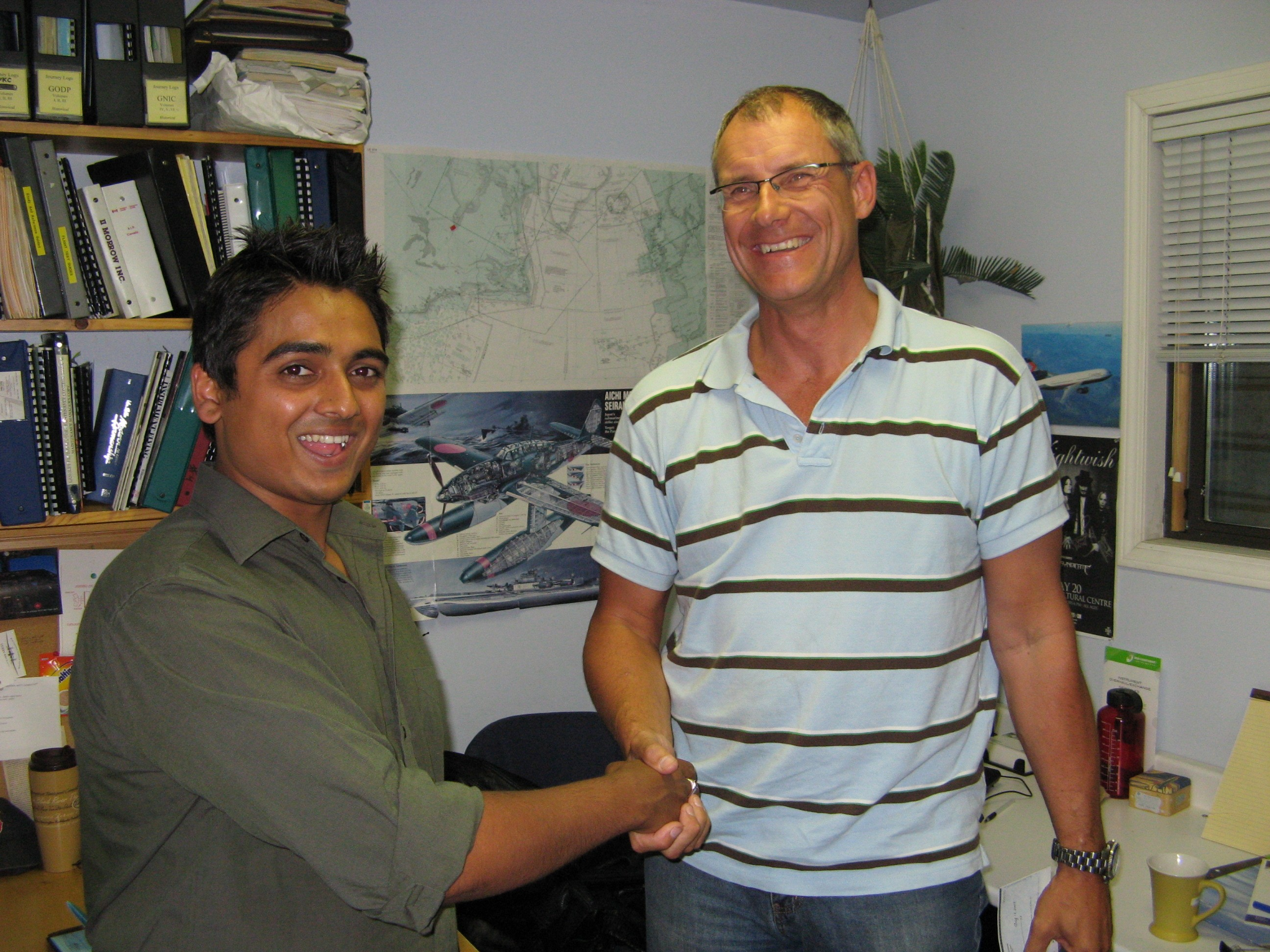 Commercial Pilot Nikhil Dongare with Pilot Examiner Matt Edwards after the successful completion of his Group 1 (Multi-engine) Instrument Rating on August 12, 2008.  Langley Flying School.