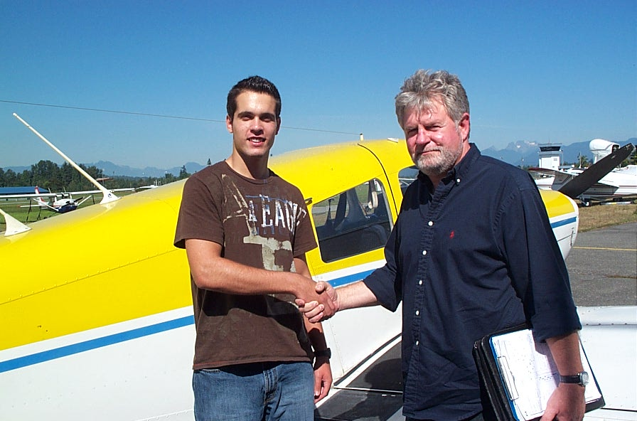 Noel Amyot with Pilot Examiner Paul Harris after the successful completion of Noel's Private Pilot Flight Test on September 14, 2008.  Langley Flying School.