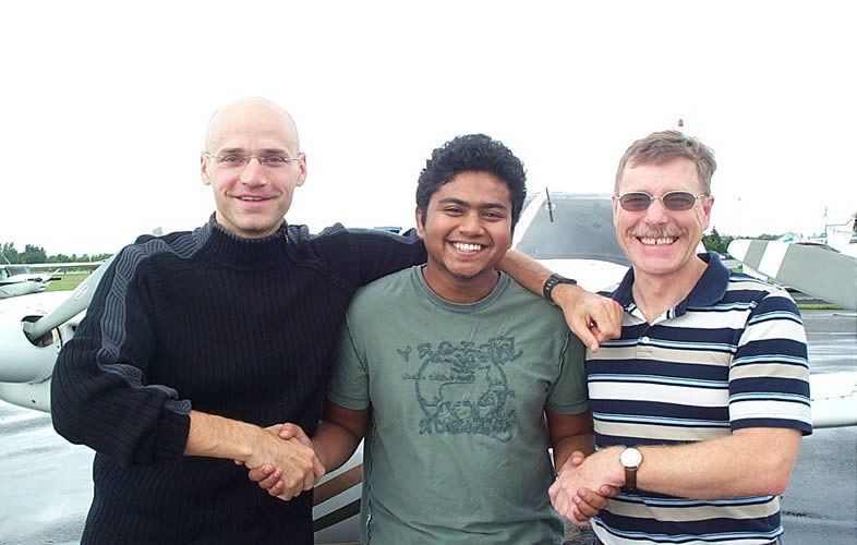 Commercial Pilot Pankaj Salve with Pilot Examiner Todd Pezer and Flight Instructor Peter Waddington after the successful completion of Panks' Flight Test for his Group 1 (Multi-engine) Instrument Rating on August 29, 2008.  Langley Flying School.