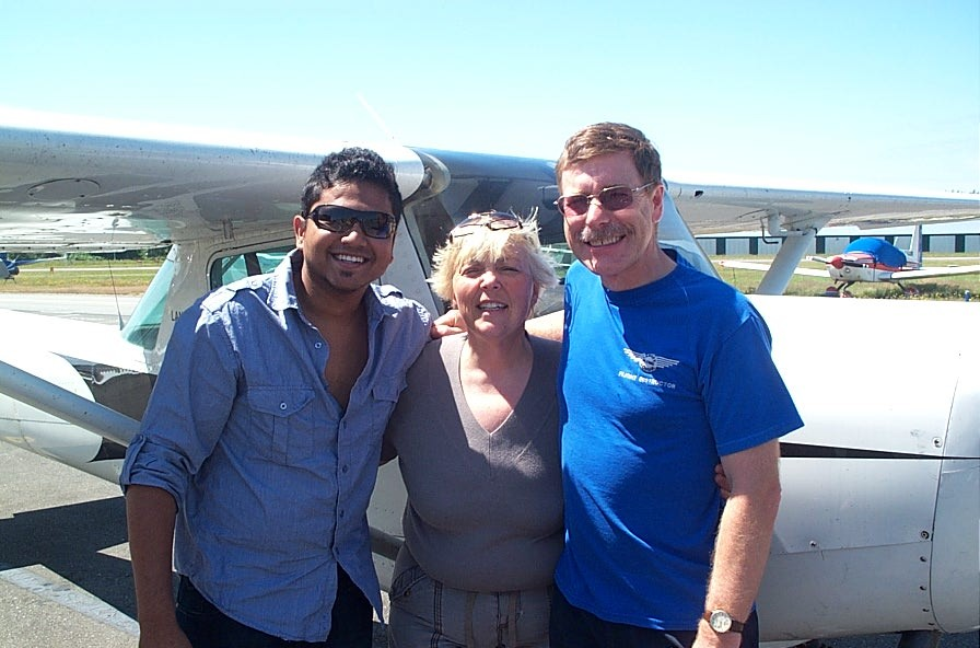 Commercial Pilot Graduate Pankaj Salve with Pilot Examiner Karen Douglas and Flight Instructor Peter Waddington after the successful completion of Panks' ride on July 8, 2008.  Langley Flying School.