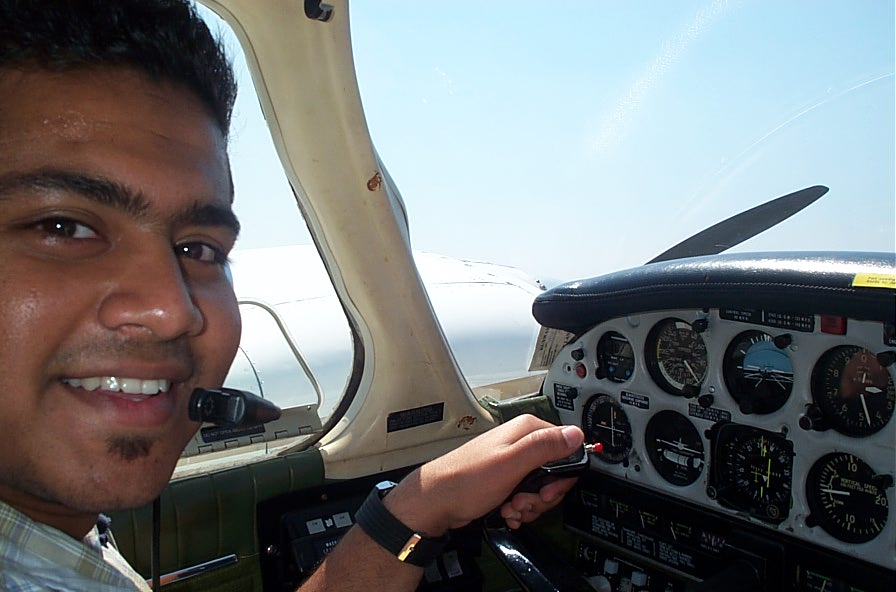 Pankaj Salve at the controls of the Piper Seneca during an engine shut-down exercise.  Langley Flying School