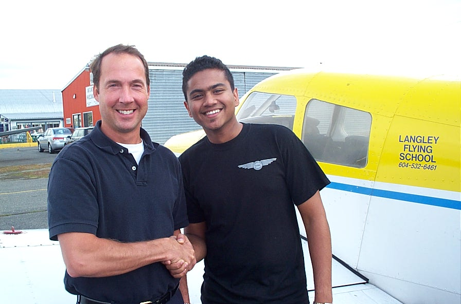 Panks Salve with Jeff Durand after the successful completion of Panks' Private Pilot Flight Test, September 5, 2007, Langley Flying School