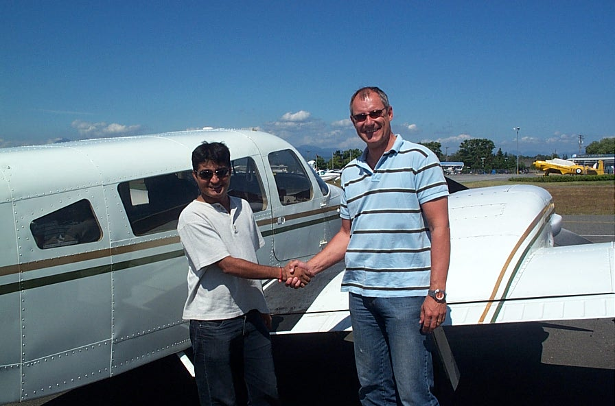 Raman Srivastava with Pilot Examiner Matt Edwards after the successful completion of Raman's Flight Test for the Multi-engine Class Rating on July 9, 2008.  Langley Flying School.