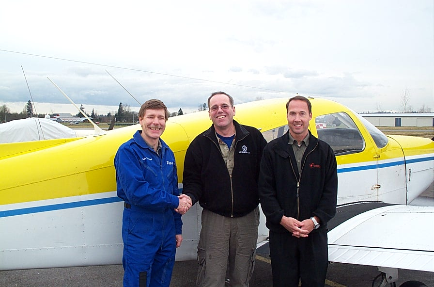 Richard Brooks receives congratulations from Flight Instructor Peter Waddington and Pilot Examiner Jeff Durrand after the successful completion of Richard's Private Pilot Flight Test on January 15, 2008.  Langley Flying School.