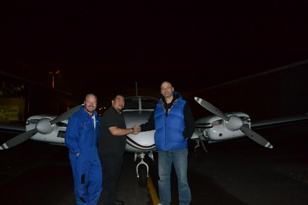 Rick Hunter receives congratulations from Pilot Examiner Todd Pezer and Chief Flying Instructor, Dave Parry after the successful completion of his Group 1 (Multi-engine) Instrument Rating on December 1, 2011.