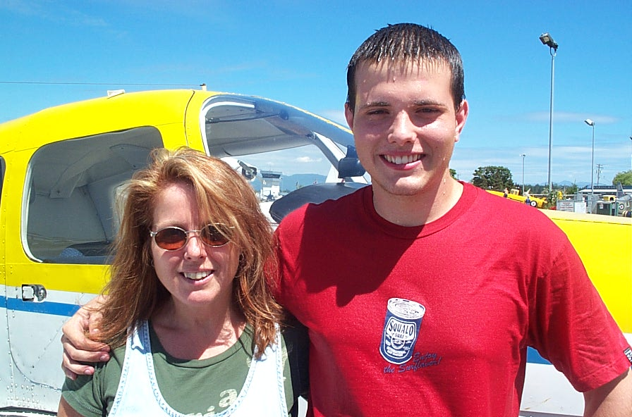 Ryan Fielding with his Mother after the completion of Ryan's First Solo Flight on July 21, 2008.  Langley Flying School