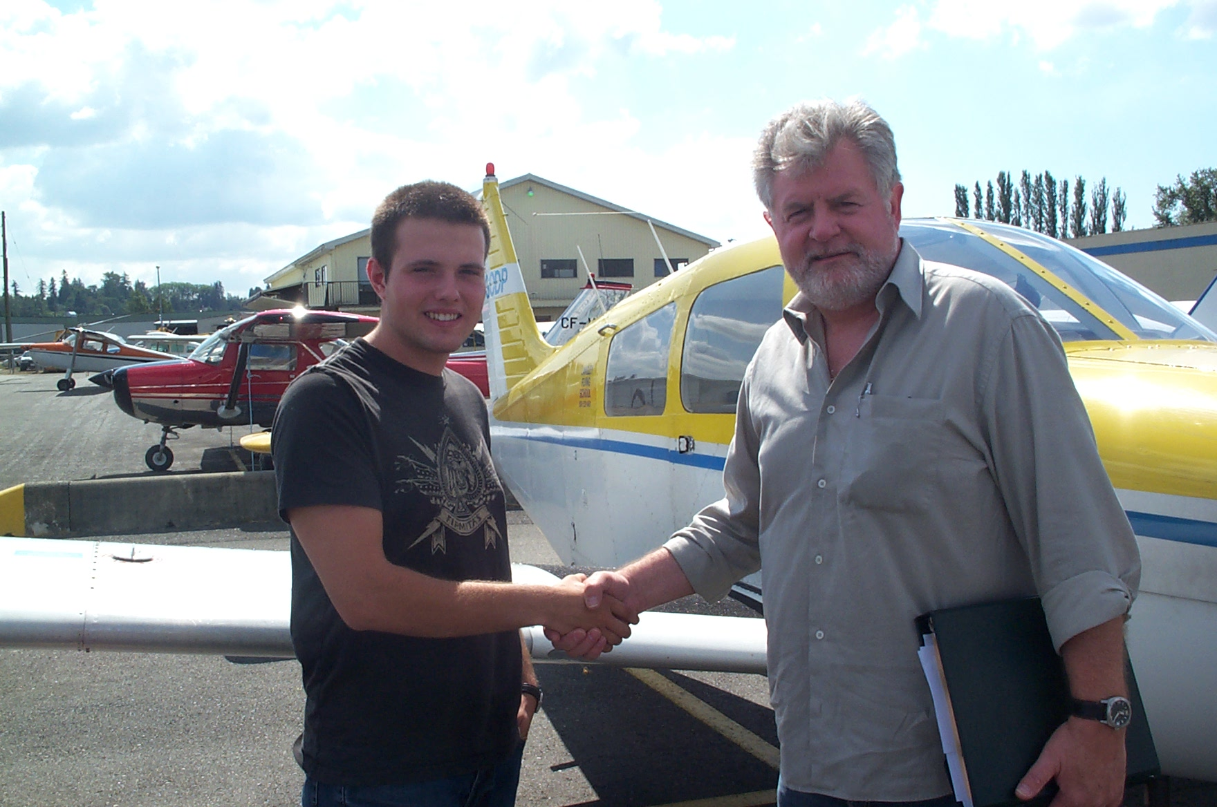 Ryan Fielding receives congrats from his Pilot Examiner Paul Harris after the successful completion of Ryan's Private Pilot Flight Test on August 30, 2010. Congratulations also to Ryan's Flight Instructor, Rita Methorst.  Langley Flying School.
