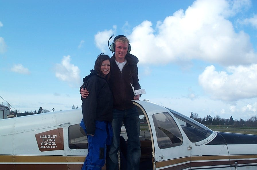 Ryan Kavanagh receives contratulations from his Flight Instructor, Naomi Jones, after the completion of Ryan's First Solo Flight.  Langley Flying School.