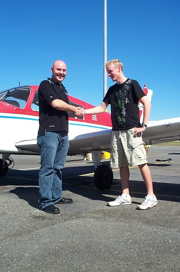 Ryan Kavanagh receives contratulations from Flight Instructor Rod Giesbrecht after the successful completion of Ryan's Private Pilot Flight Test on September 7, 2008. Langley Flying School.