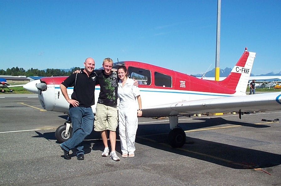 Ryan Kavanagh with Flight Instructor Rod Giesbrecht and Naomi Jones after the successful completion of Ryan's Private Pilot Flight Test.  Langley Flying School.