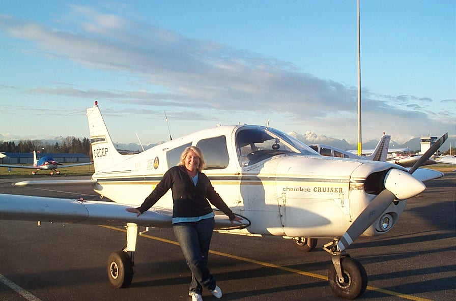 Sandy Wade with Cherokee GCEP after the completion of her First Solo Flight on March 8, 2010.  Congratulations also to Sandy's Flight Instructor, Naomi Jones.  Langley Flying School.