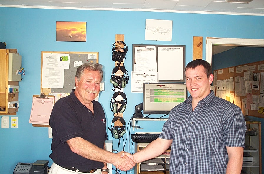 Scott Little receives congratulations from Pilot Examiner and Transport Canada Inspector John Mrazek after the successful completion of his Group 1 (Multi-engine) Instrument Rating Flight Test on May 30, 2008.  Langley Flying School.