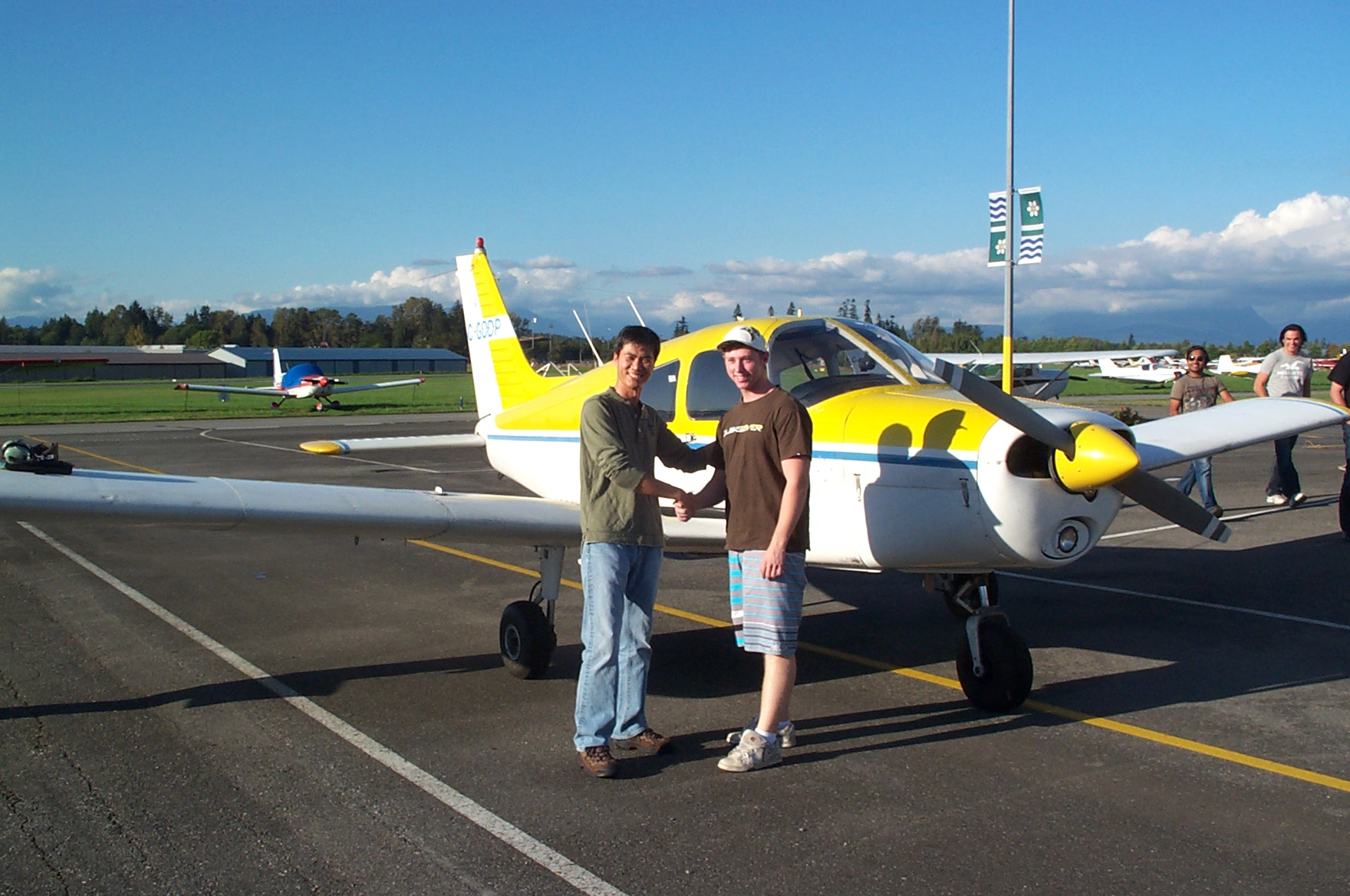 Sheldon Hemmingway is congratulated by Flight Instructor Hoowan Nam after the completion of Sheldon's First Solo Flight in Cherokee GODP on September 28, 2010. Langley Flying School.