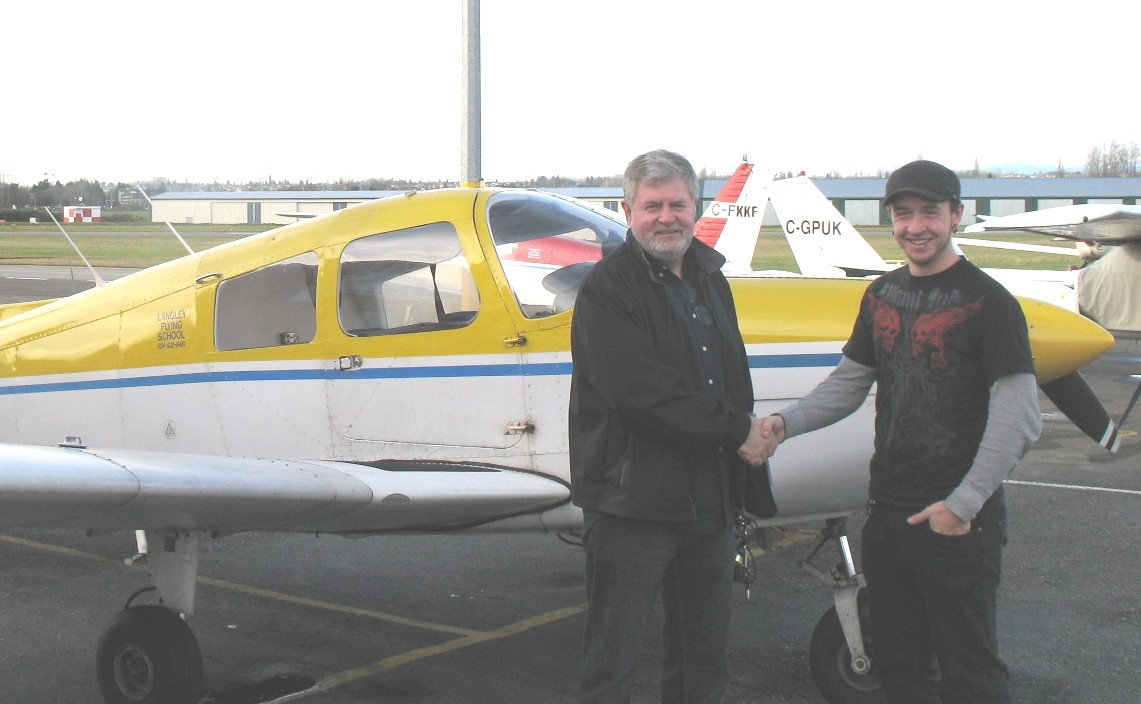 Steve Dirks with Pilot Examiner Paul Harris after the successful completion of Steve's Private Pilot Flight Test.  November 23, 2008.  Langley Flying School.