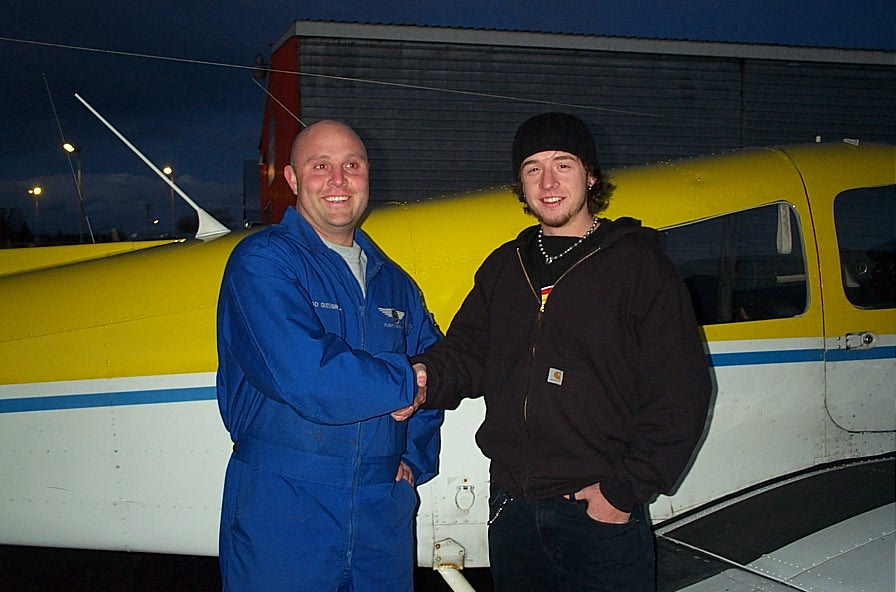 Steve Dikes with Flight Instructor Rod Giesbrecht after the completion of Steve's First Solo Flight on February 10, 2008.  Langley Flying School.