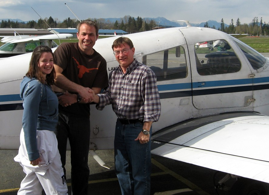 Steve Gallagher with Flight Instructor Naomi Jones and Pilot Examiner John Laing after the successful completion of Steve's Private Pilot Flight Test on April 20, 2008.  Langley Flying School.
