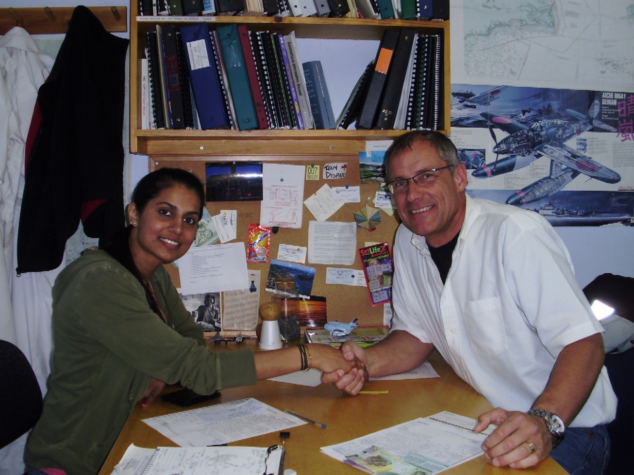 Commercial Pilot Sukhmani Brar with Pilot Examiner Matt Edwards after the successful completion of the Flight Test for Sukhmani's Group 1 (Multi-engine) Rating on May 28, 2009.  Langley Flying School.