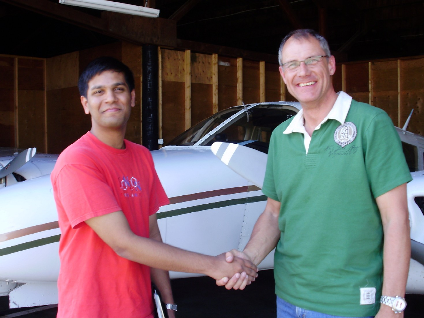 Commercial Pilot Suraj Canakapalli is congratulated by Pilot Examiner Matt Edwards after the successful completion of Suraj's Multi-engine Class Rating Flight Test on June 2, 2009.  Congrats also to Suraj's Flight Instructor Philip Craig.  Langley Flying School.