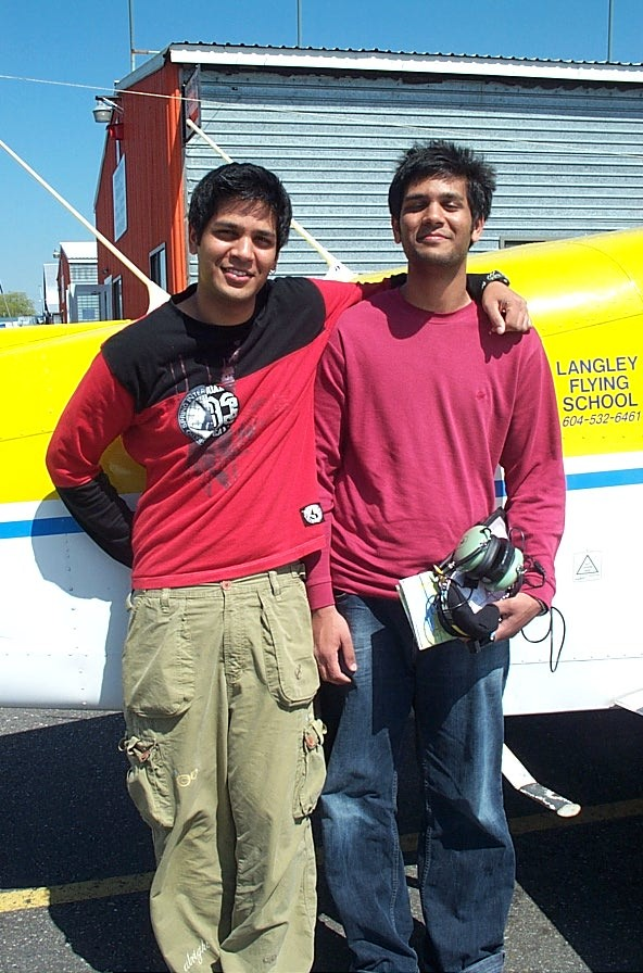Suraj Canakapalli with his brother Sagar after the completion of Sagar's Private Pilot Flight Test.  Langley Flying School.